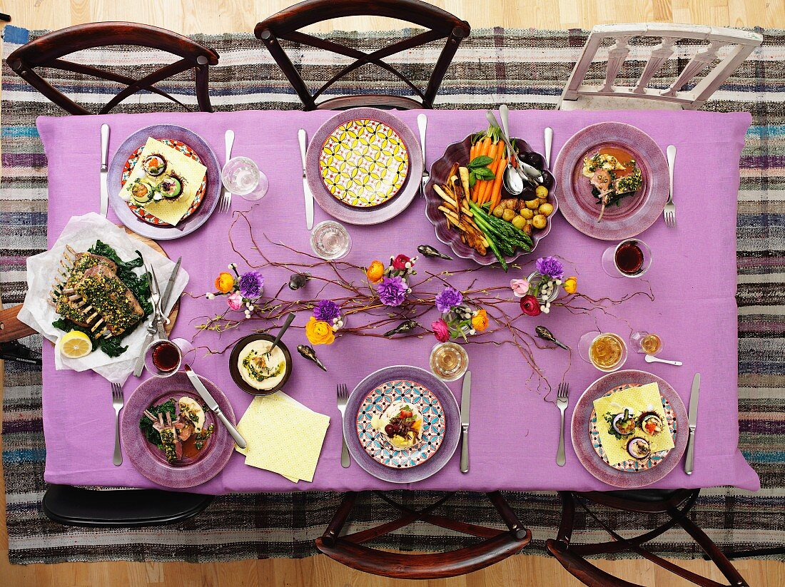 A bird's eye view of a springtime table laid with sweet and savoury dishes