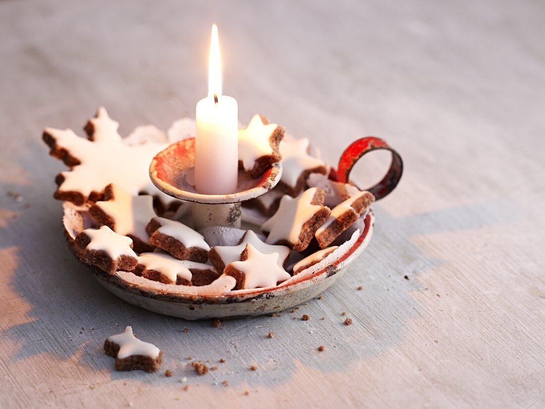 Cinnamon stars in an old-fashioned candle holder