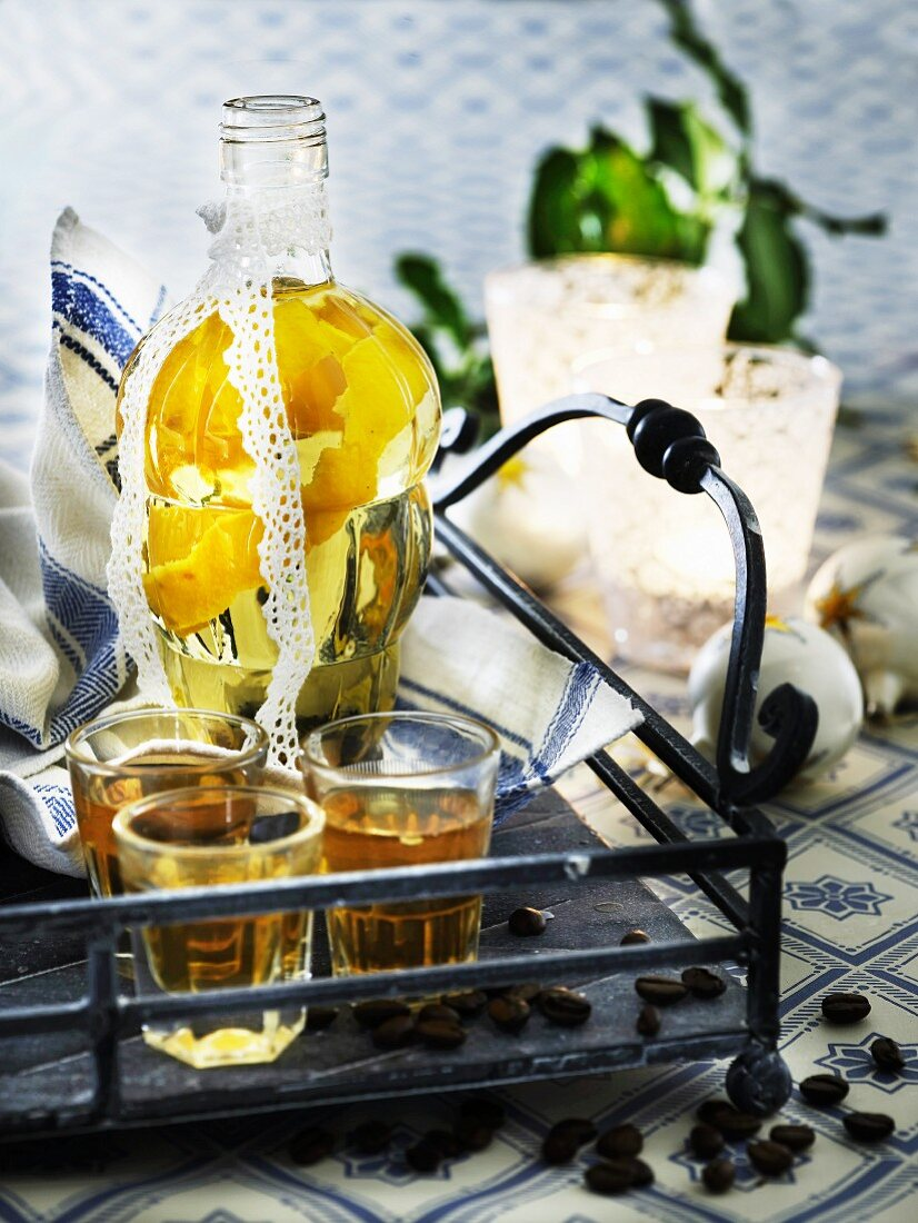 Lemon schnapps in bottles and glasses (Christmas)