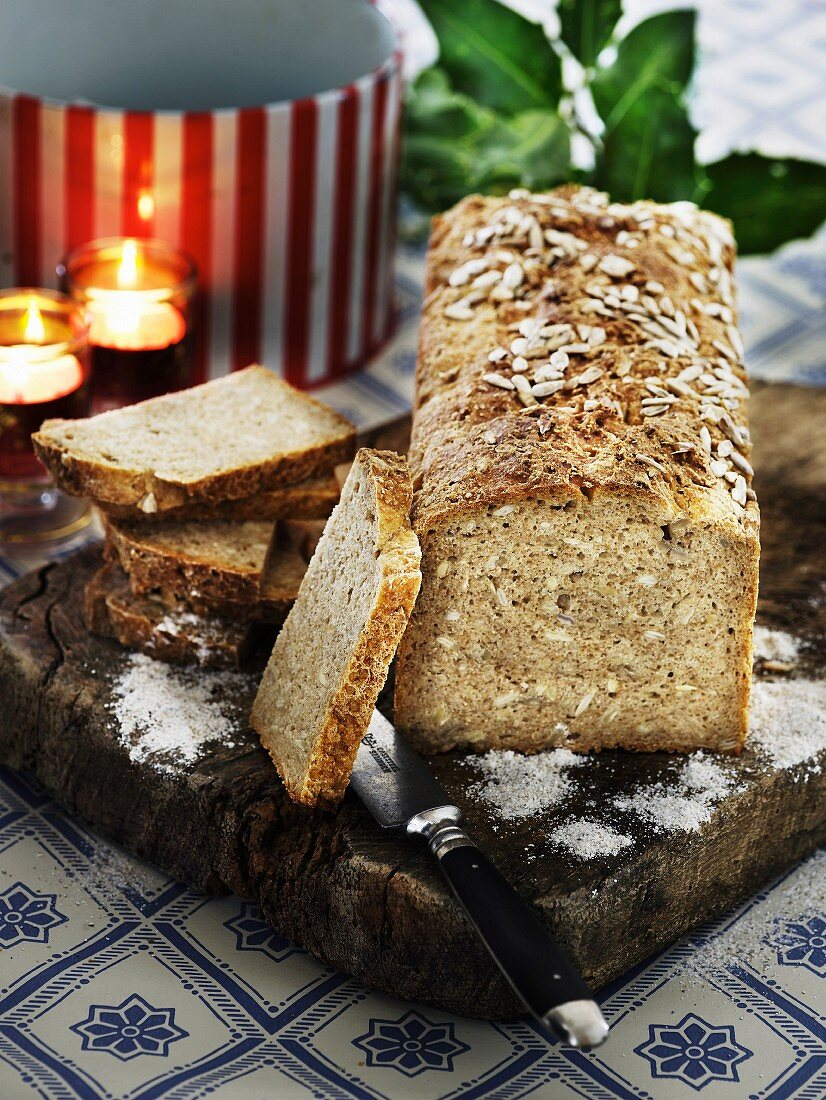 Rustic wholemeal bread on a wooden board for Christmas
