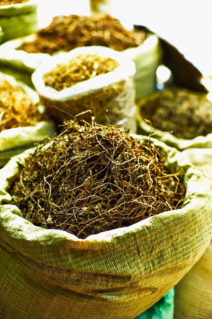 Sacks of dried herbs at a market in Saigon (Vietnam)