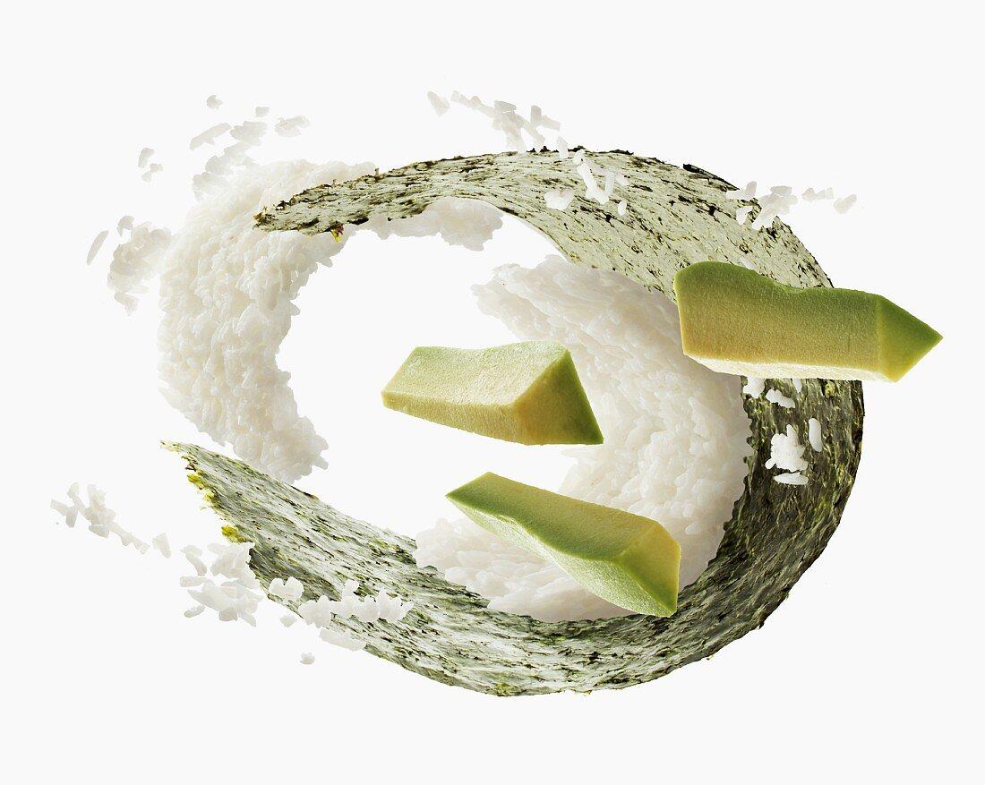 Flying sushi ingredients (nori, rice, avocado)
