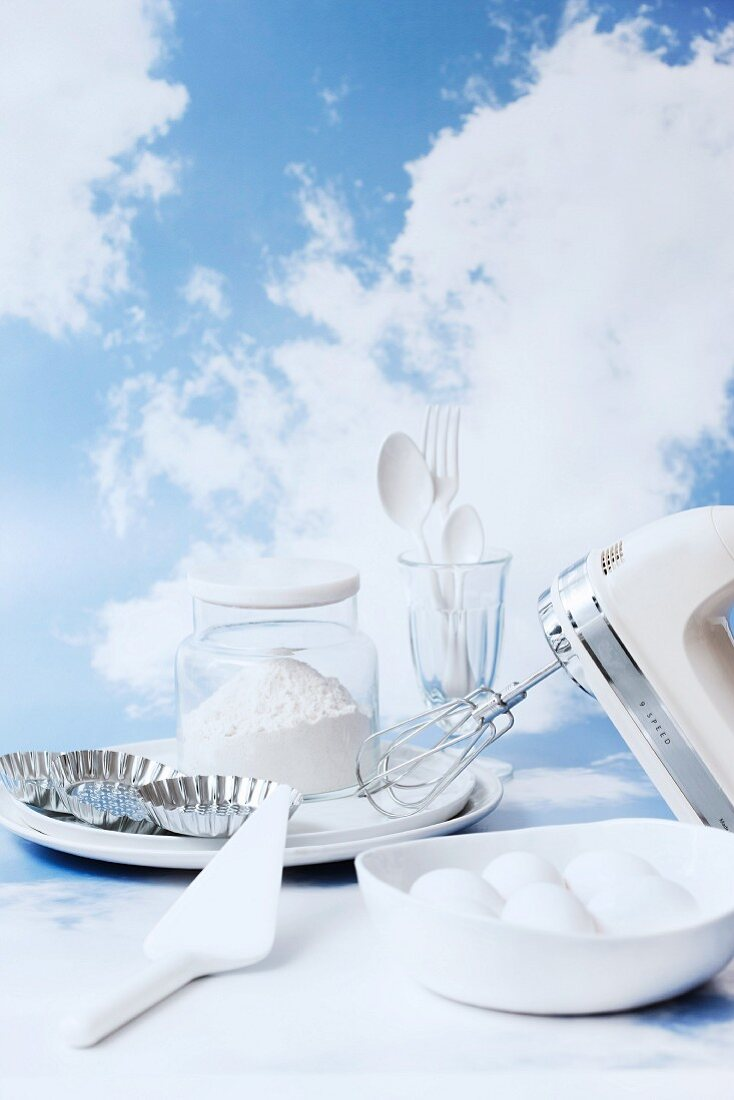 White baking ingredients and kitchen utensils
