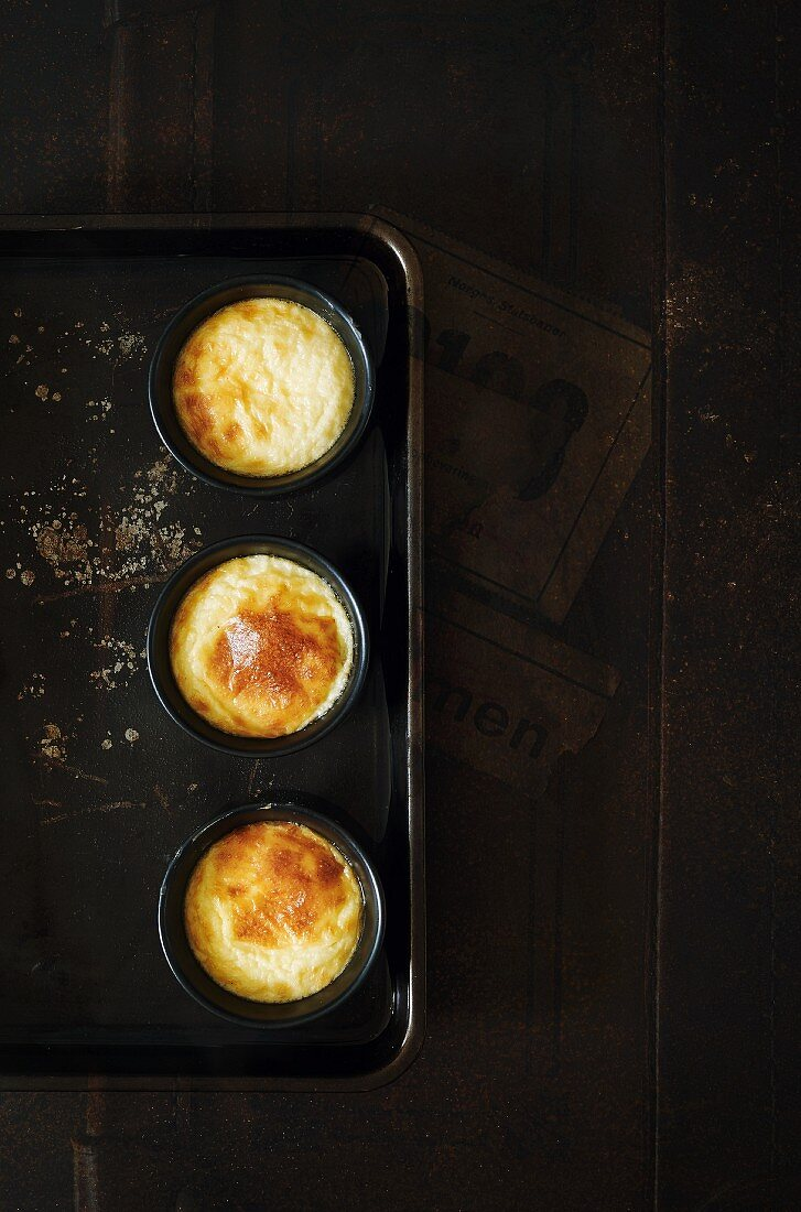 Souffles with goat's cheese on a dark surface