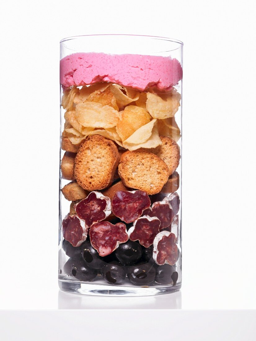 Ingredients for Mediterranean appetisers layered in a glass container