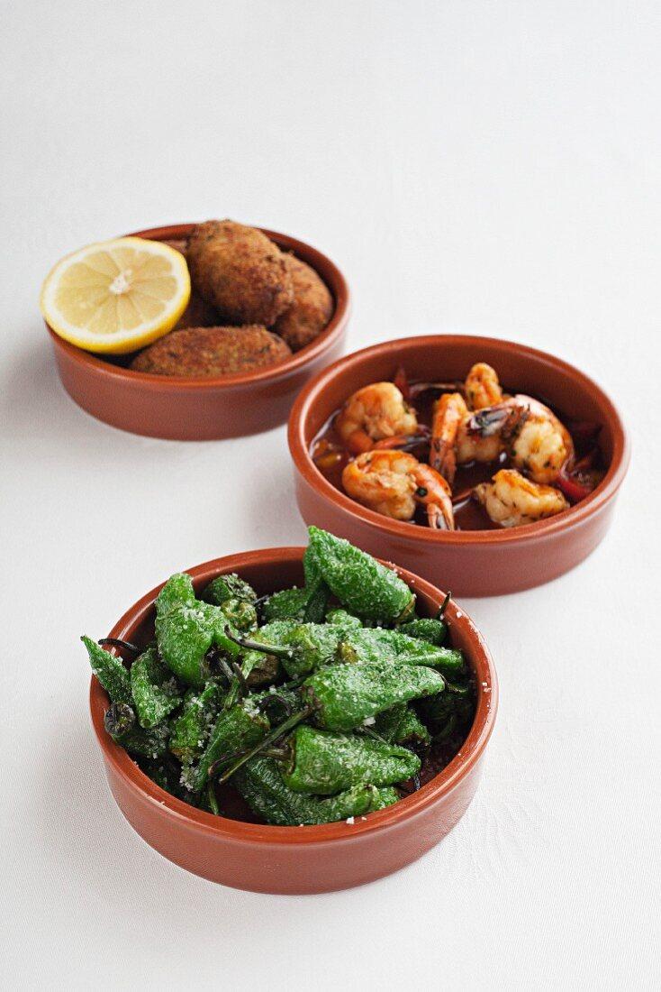 Various tapas: pimientos de patron, prawns and croquettes