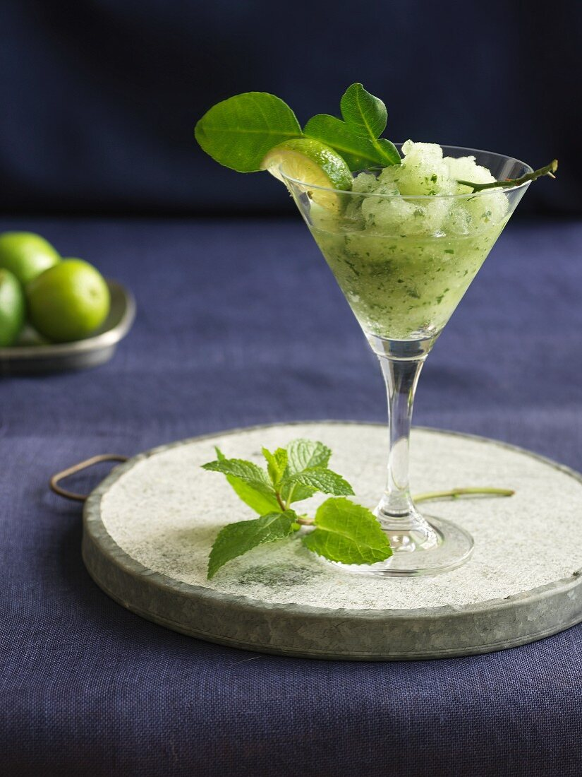 Frozen lime margarita with mint and a kaffir lime leaf