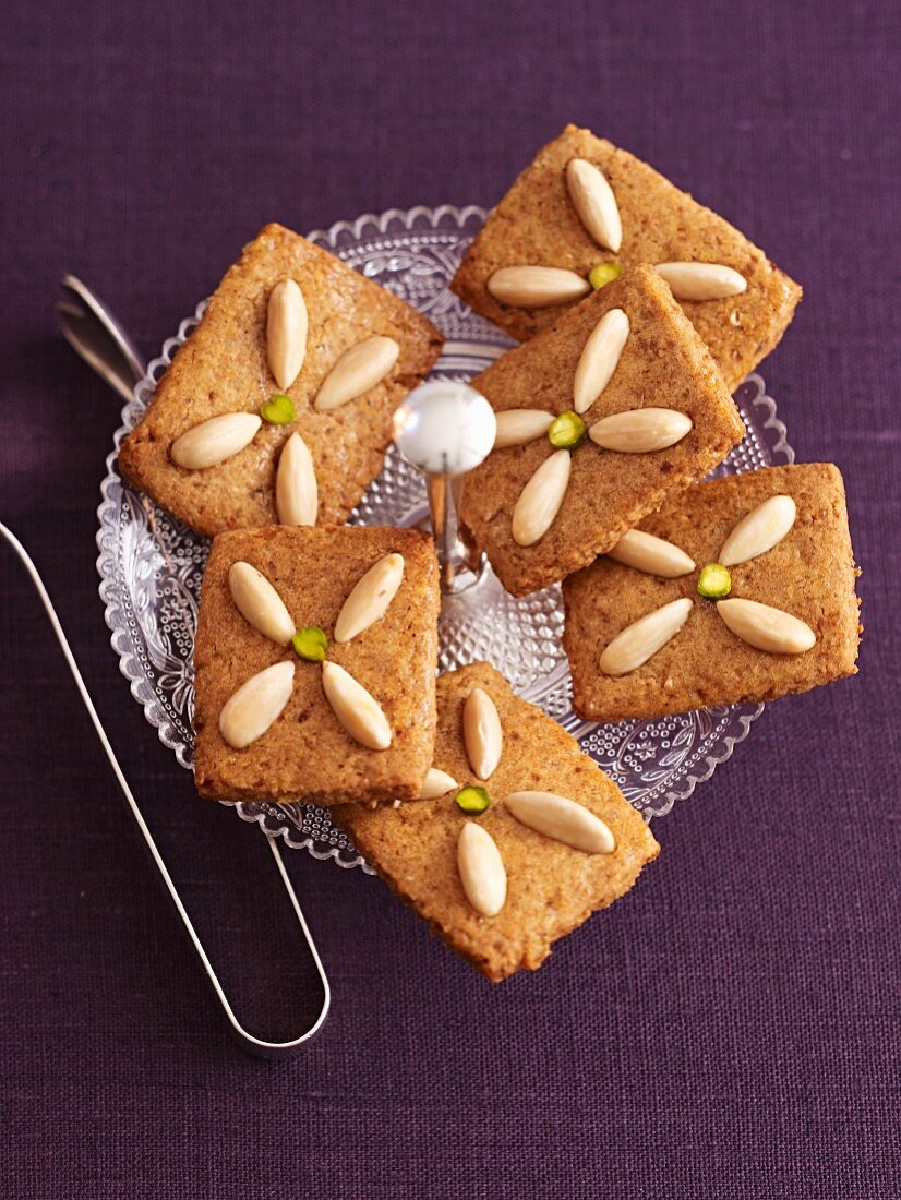 Almond biscuits on a glass plate