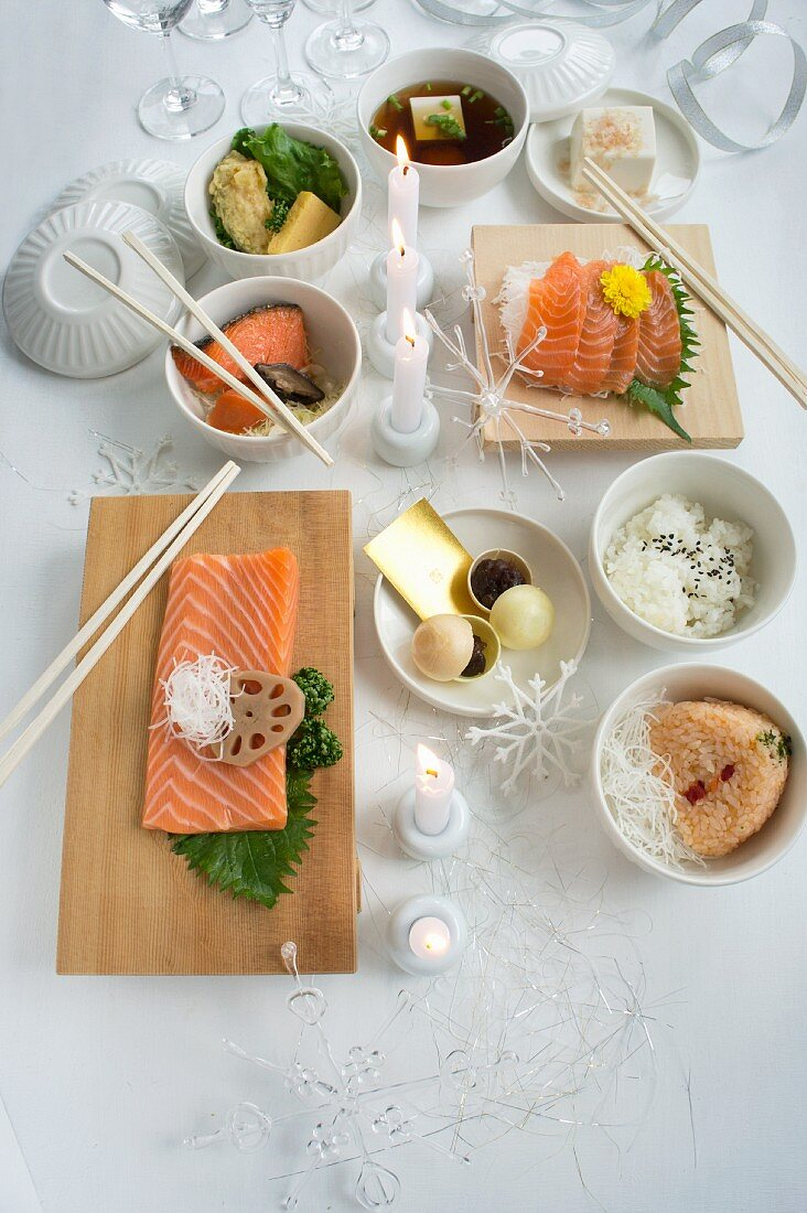 A table laid for Christmas with a variety of Japanese dishes