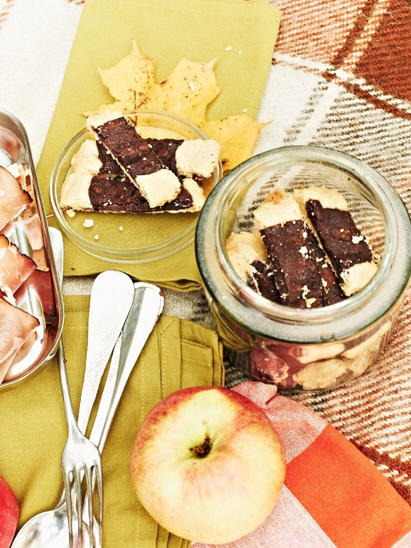 Shortbread biscuits with chocolate and fresh apple for an autumnal picnic