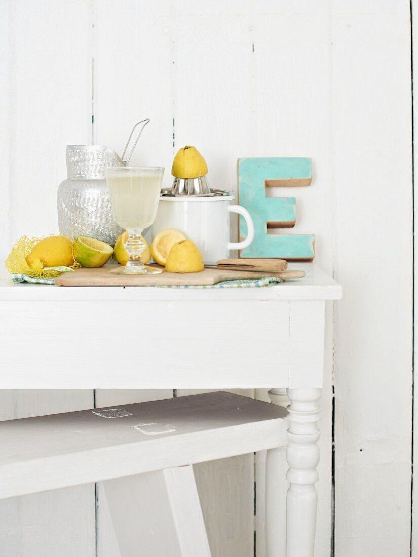 Homemade lemonade and squeezed lemons