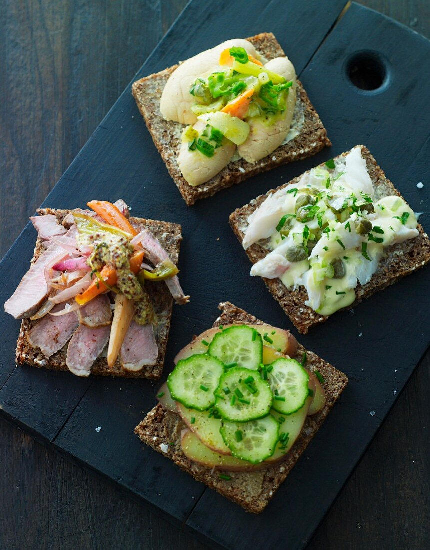 Slices of wholemeal bread with various toppings
