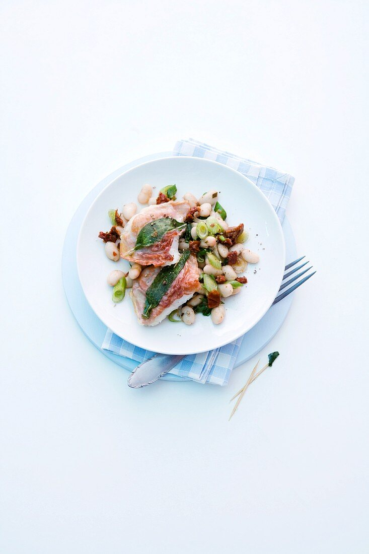 Cod saltimbocca on a bean medley