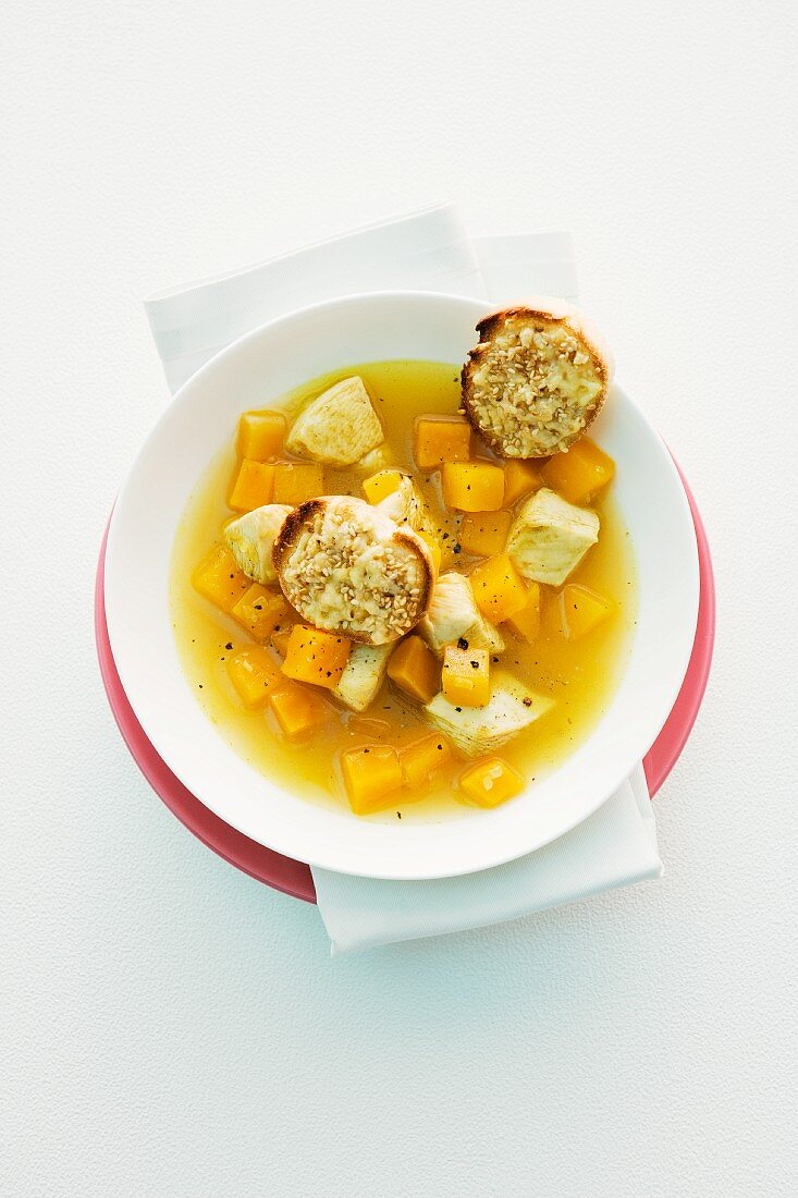 Pumpkin soup with chicken and baguette