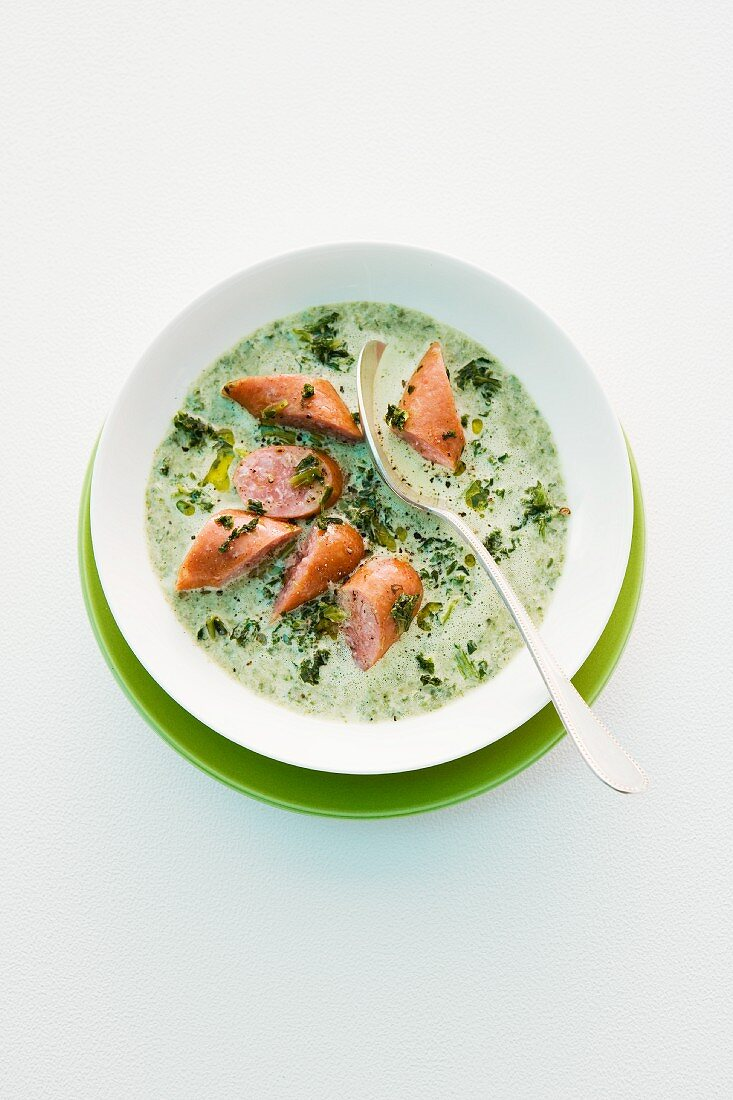 Winter soup with green cabbage and Mettwurst sausage