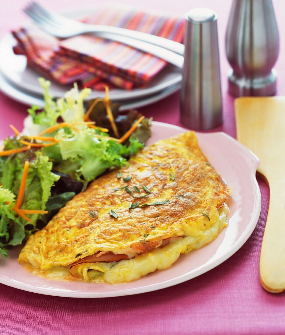Ham and cheese omelette with a green salad