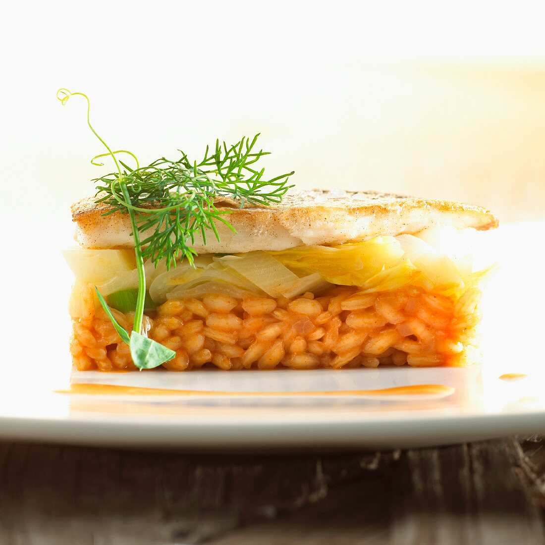 Fish fillet with chicory on a bed of risotto