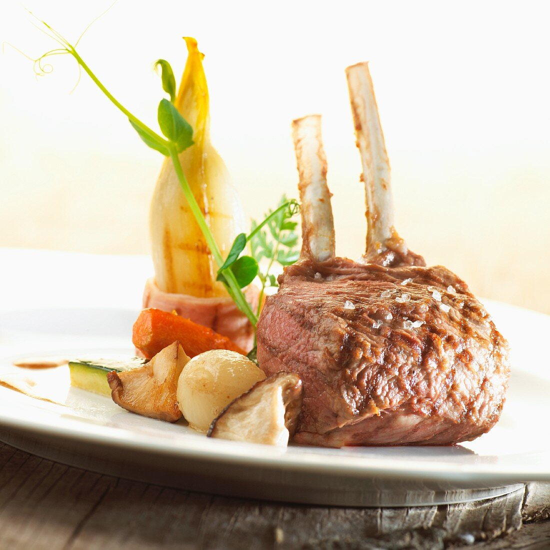 A lamb chop with herb butter and grilled chicory