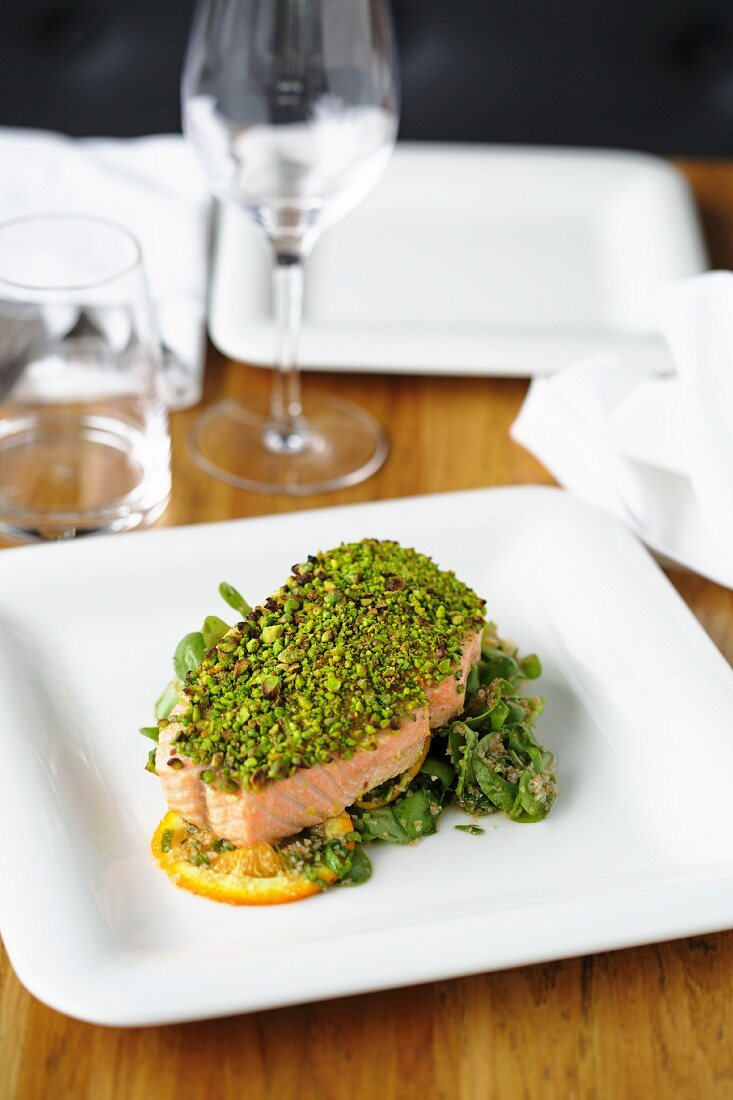 Salmon fillet on baby spinach