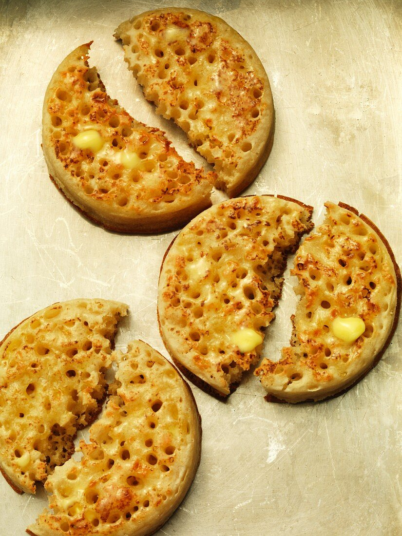 Buttered crumpets, halved