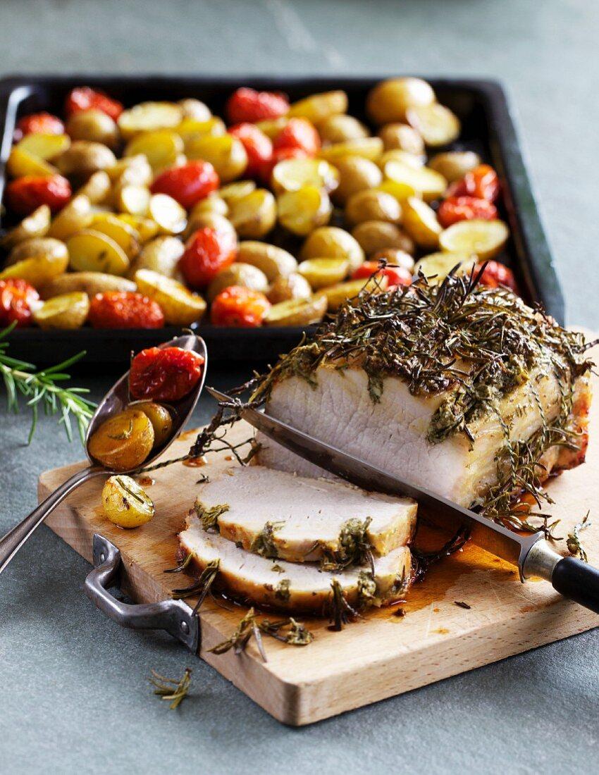 Herb roast pork with roast potatoes