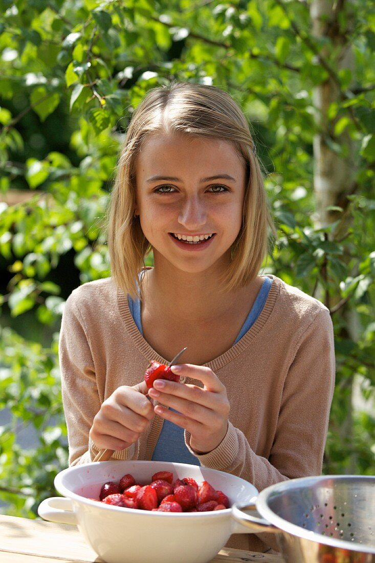 A girl preparing strawberries