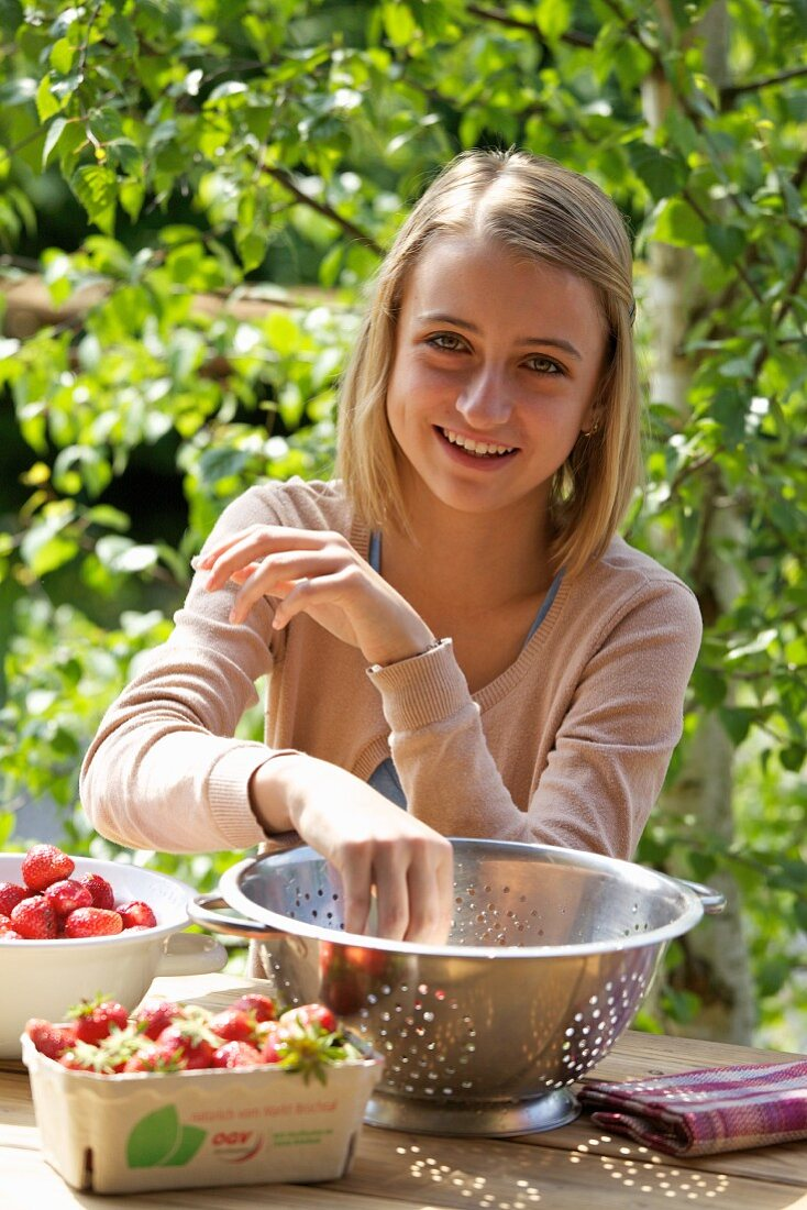 A girl with fresh strawberries