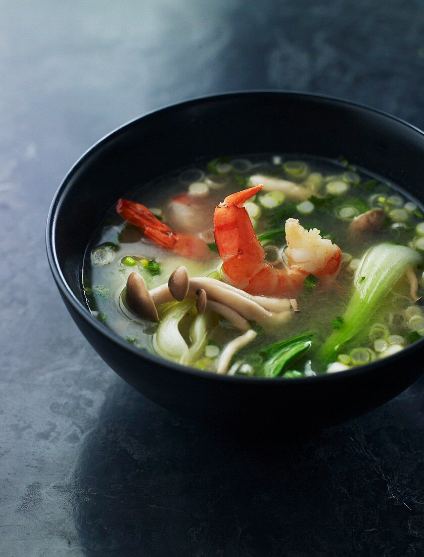 Asian soup with mushrooms, bok choy and prawns