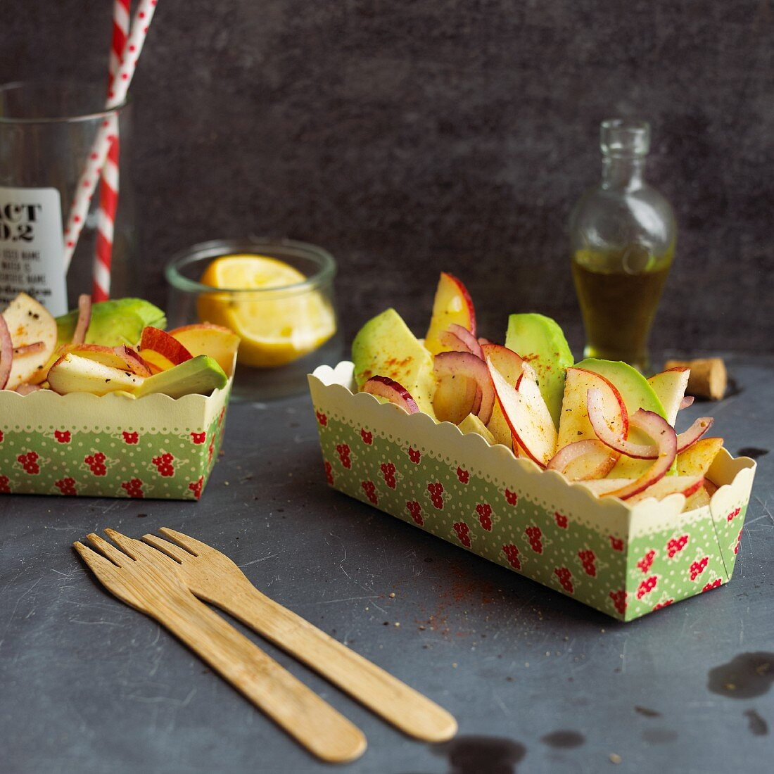 Fruity avocado salad in two paper dishes
