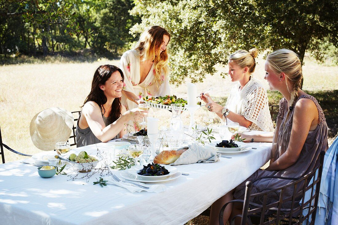 A table laid for a Provençal food in a garden