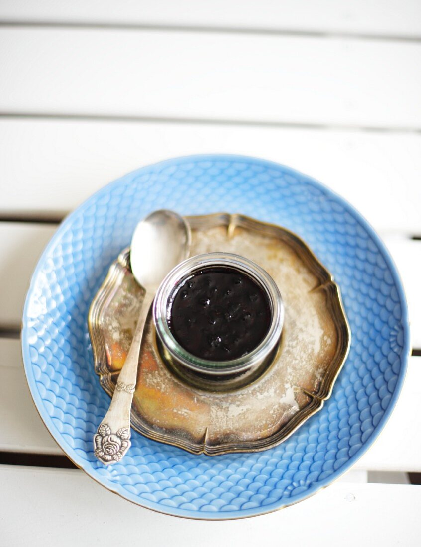 A jar of blueberry jam with passion fruit