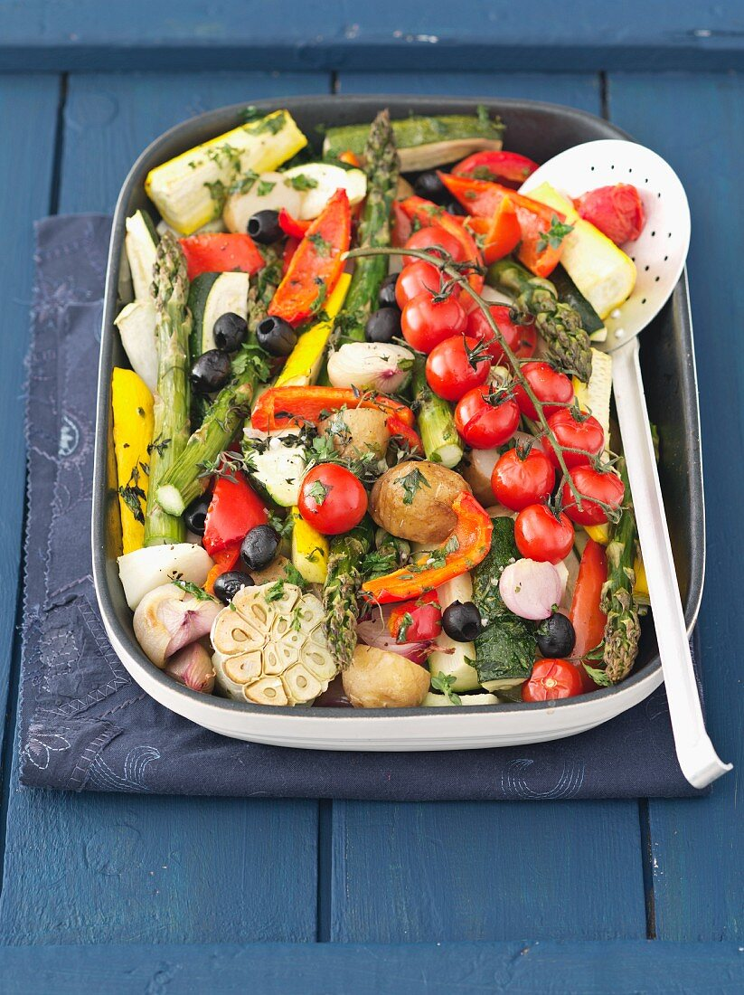 Roasted vegetables: potatoes, tomatoes, courgettes and asparagus