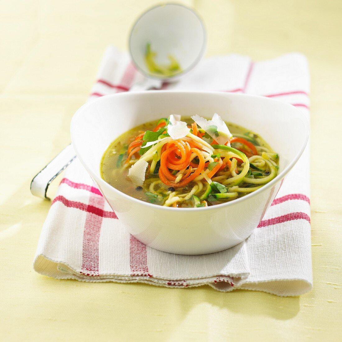 Minestrone with courgette spaghetti and Parmesan
