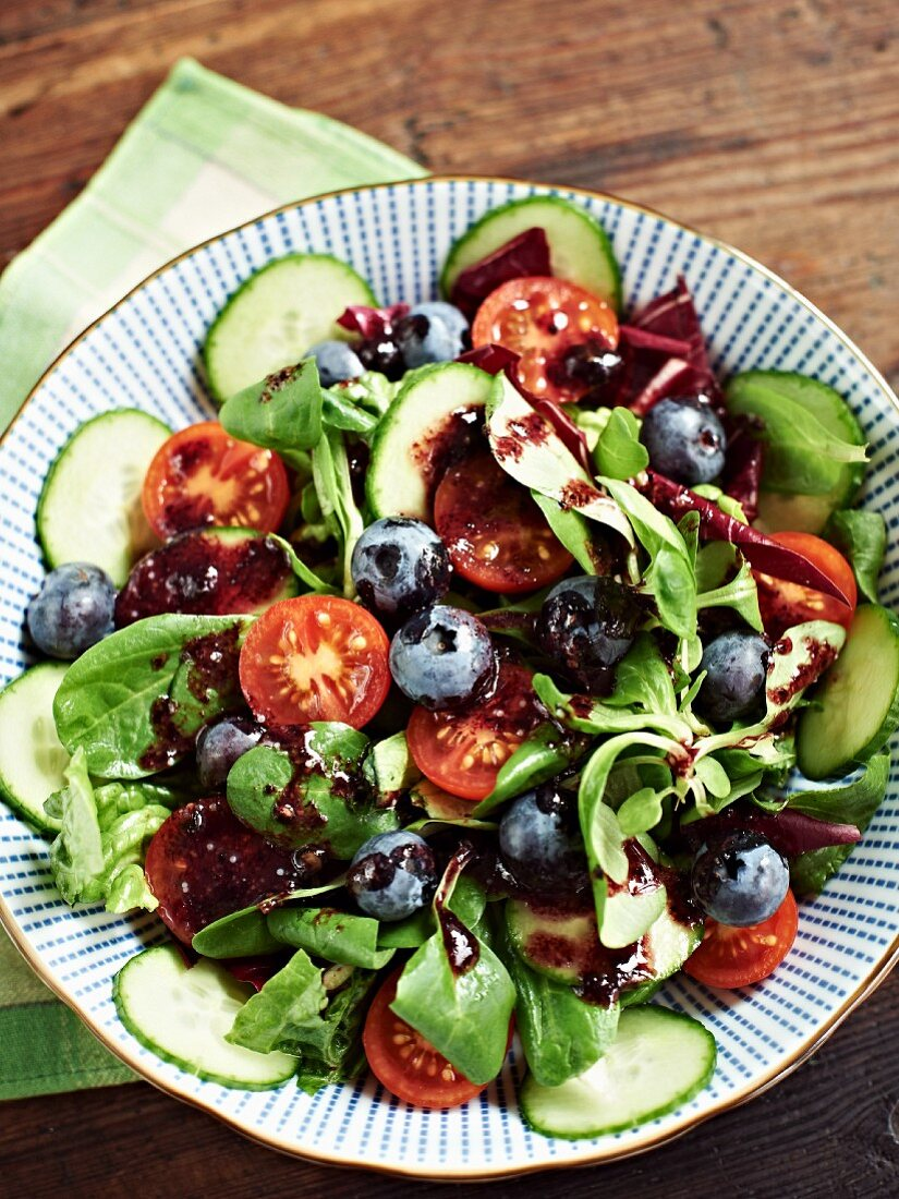 Lamb's lettuce with cherry tomatoes, cucumber, blueberries and a sweet blueberry and balsamic vinegar dressing