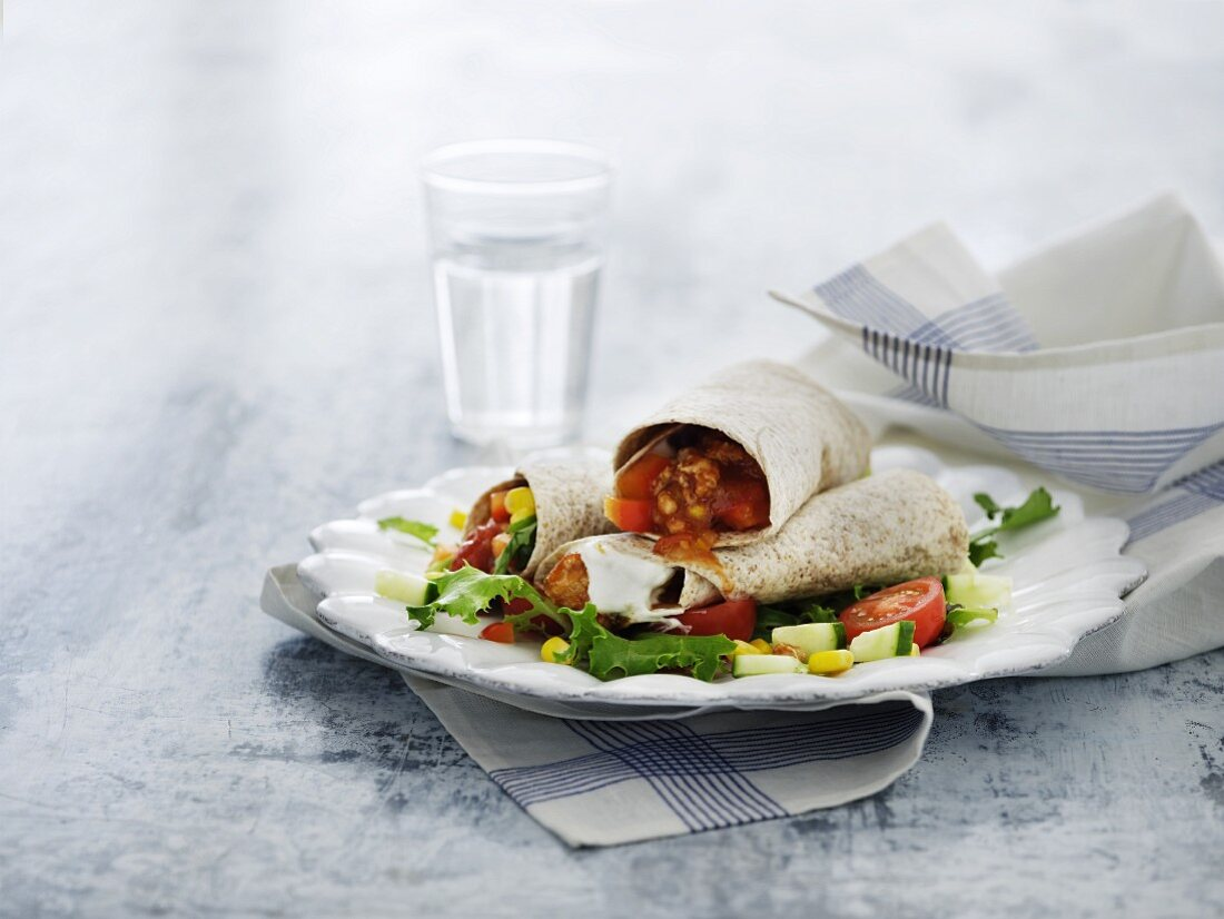 Whole grain tortillas stuffed with mince sauce and vegetables