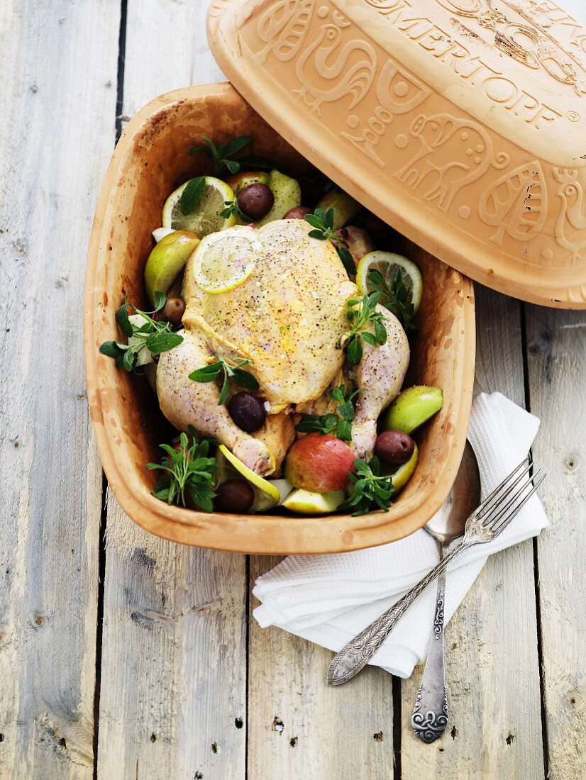 Apple chicken in a terracotta baking dish