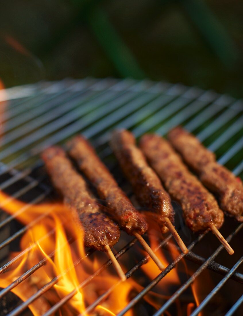 Minced meat skewers on a barbecue