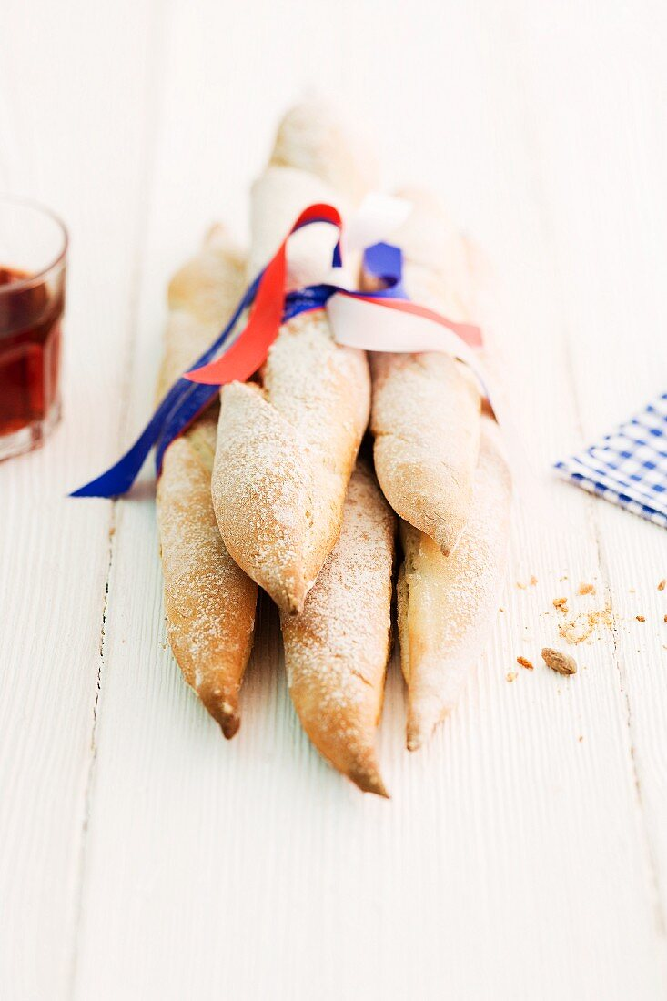 Light sourdough baguettes tied together with a ribbon