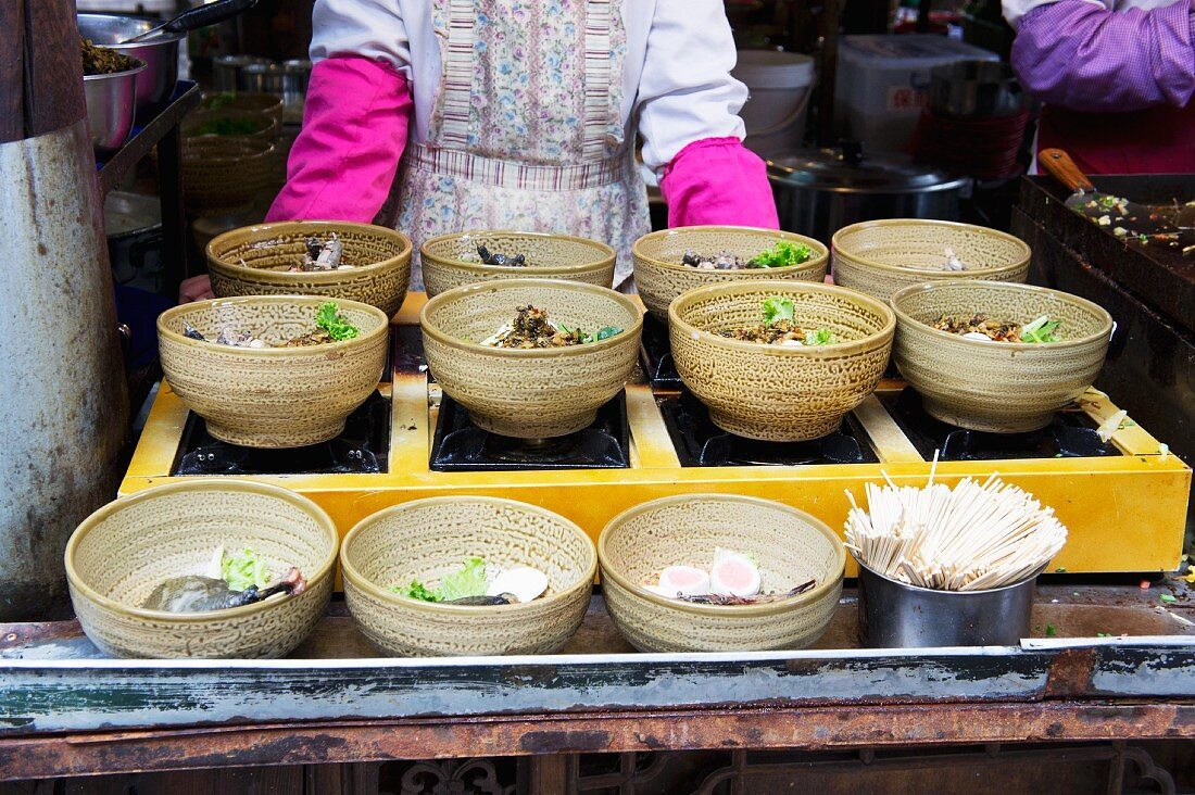 Bowls of soup in a restaurant (Lijiang, China)