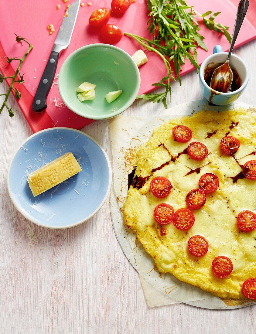 Polenta pizza with cherry tomatoes