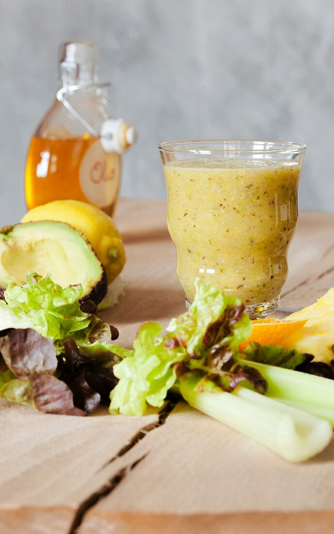 A vegetable smoothie made with lettuce, avocado and celery