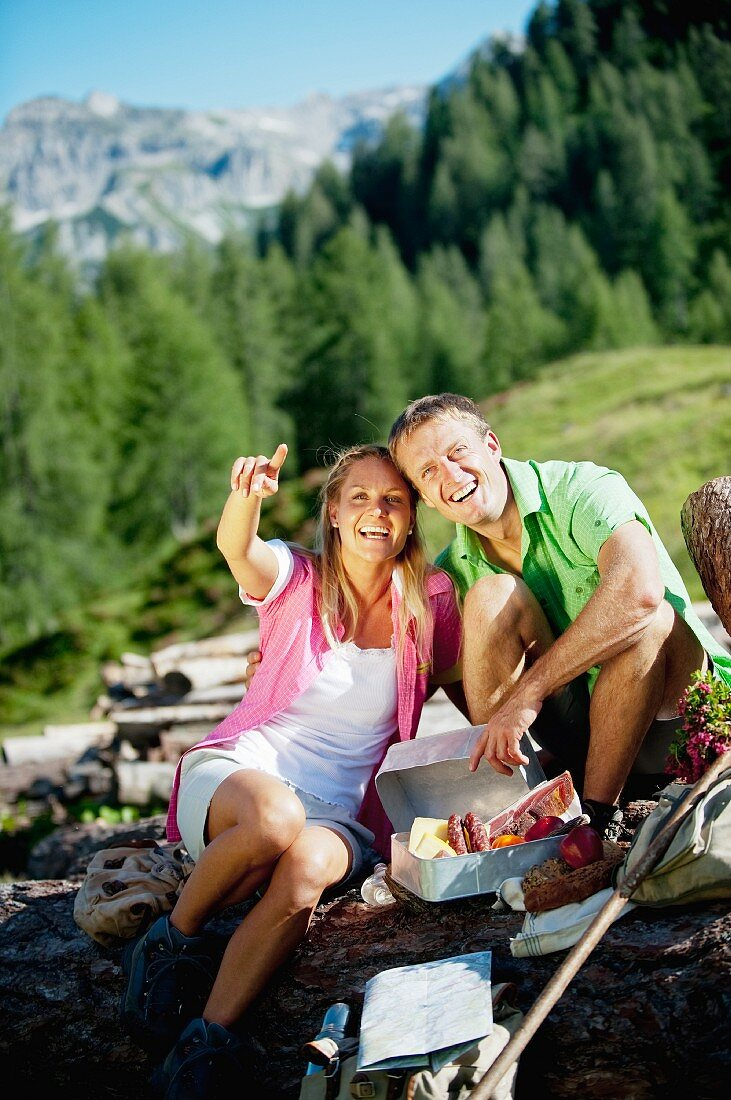 A couple having a picnic in the mountains (Austria)