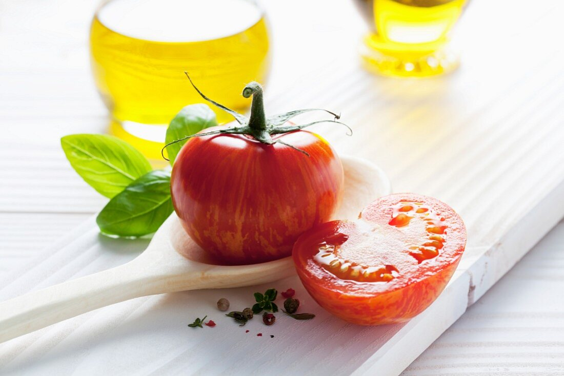 A Red Zebra tomato on a wooden spoon