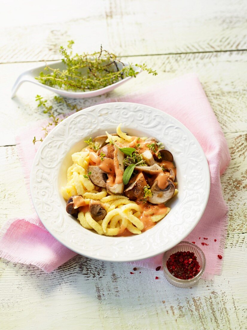 Spätzle (soft egg noodles from Swabia) with mushrooms and tomato cream