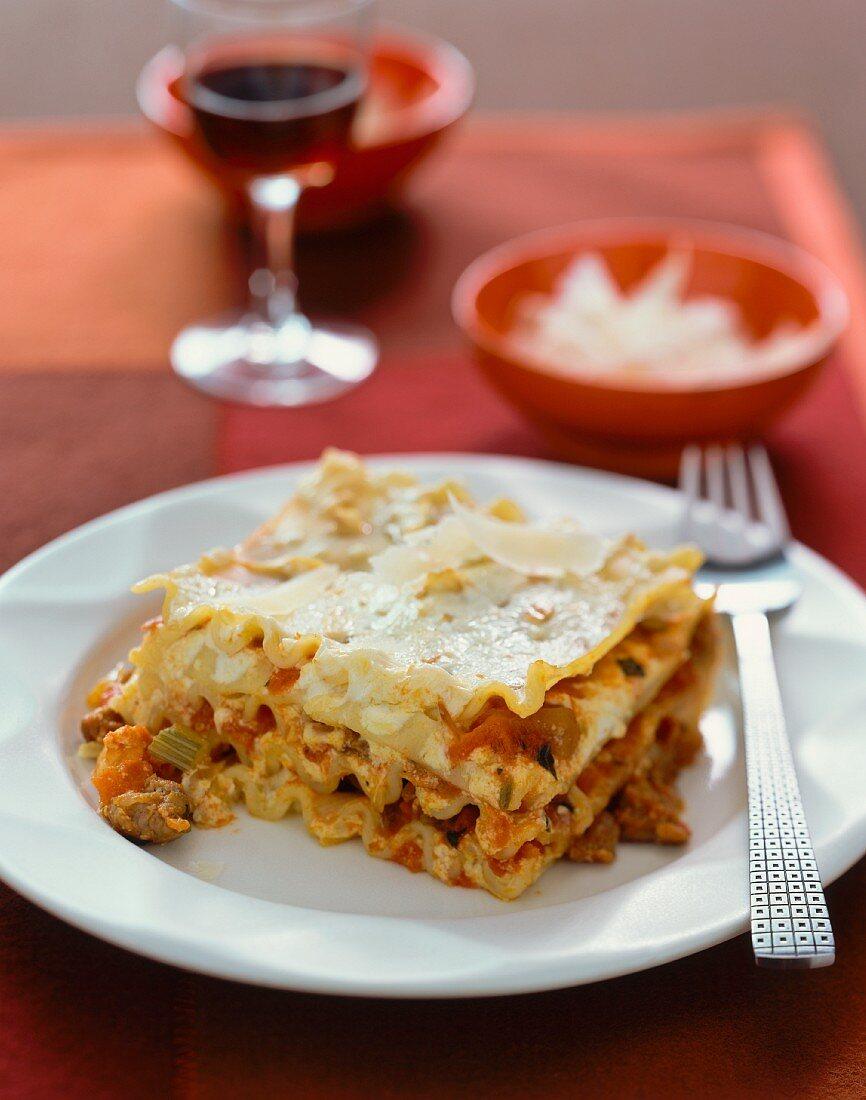 A portion of lasagne with Parmesan