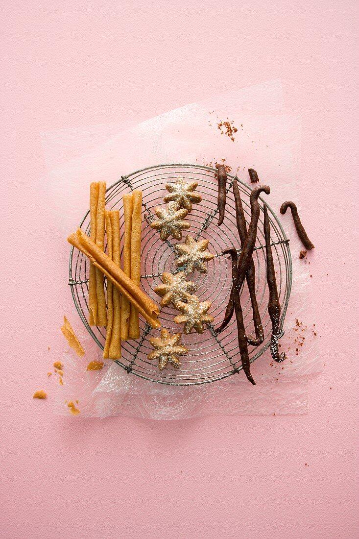 Crispy cinnamon wafer sticks, aniseed stars and baked vanilla pods