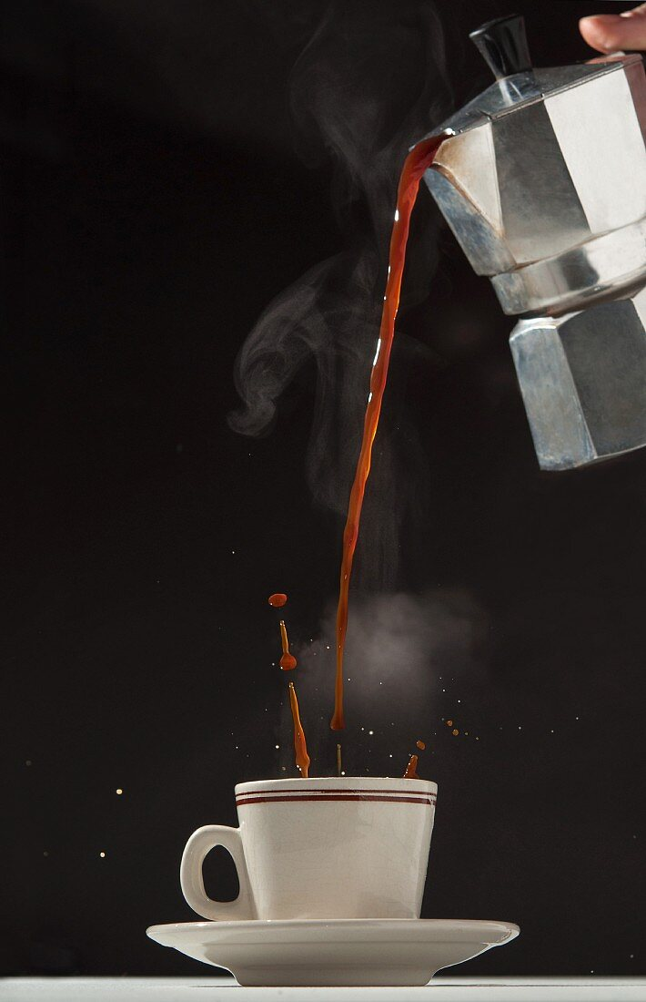 An espresso being poured