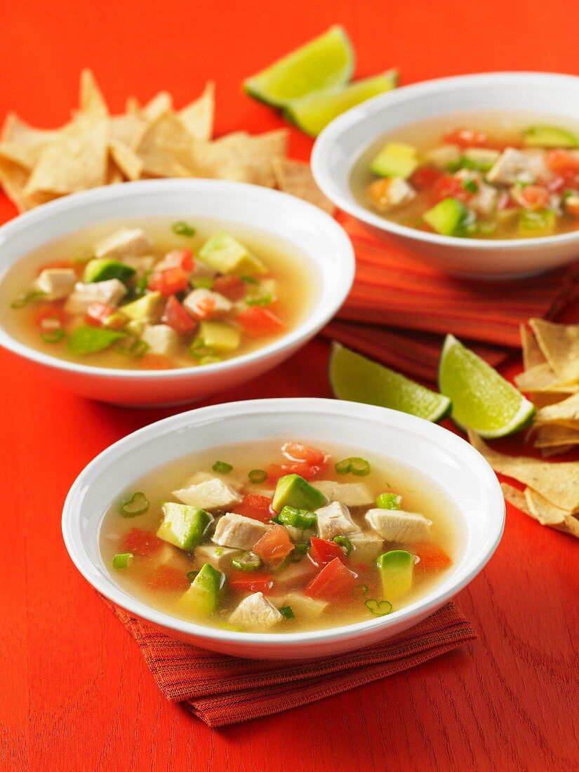 Mexican chicken soup with avocado and tomatoes