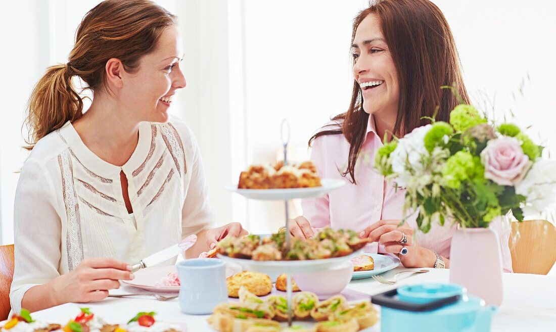 Women enjoying afternoon tea with spicy pastries