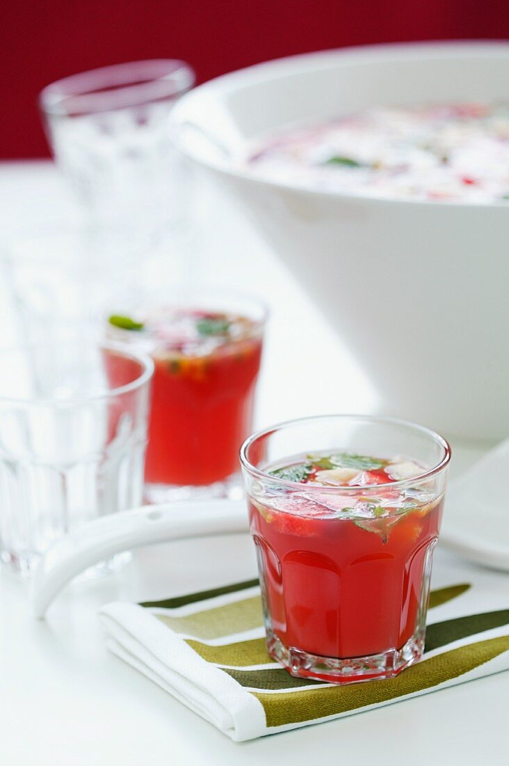 Fruit punch in glasses and in a punchbowl
